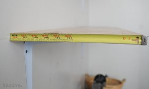Use a busted tape measure to decorate shelves - choose-to-thrive.com